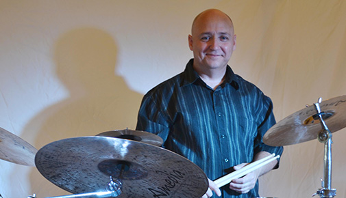 Artist Brian Melik and his drum set