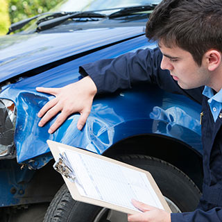 Individual assessing damage a vehicle received in an accident