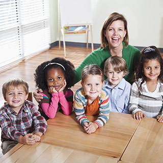 Child care director at a table with children