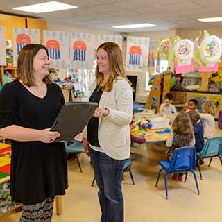 Teachers and children in the child care center