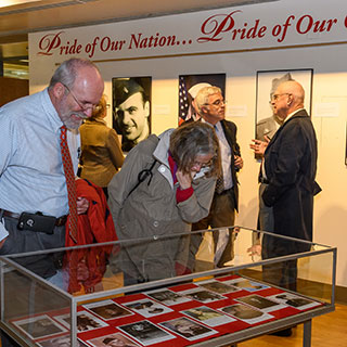 Visitors looking at exhibit in library atrium