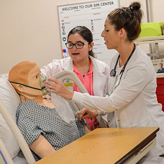 Respiratory care professional working on a dummy