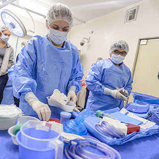 Surgical technologist preparing medical tools