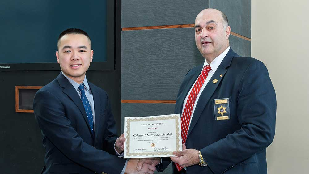 Criminal Justice student receiving the Sheriff's Award
