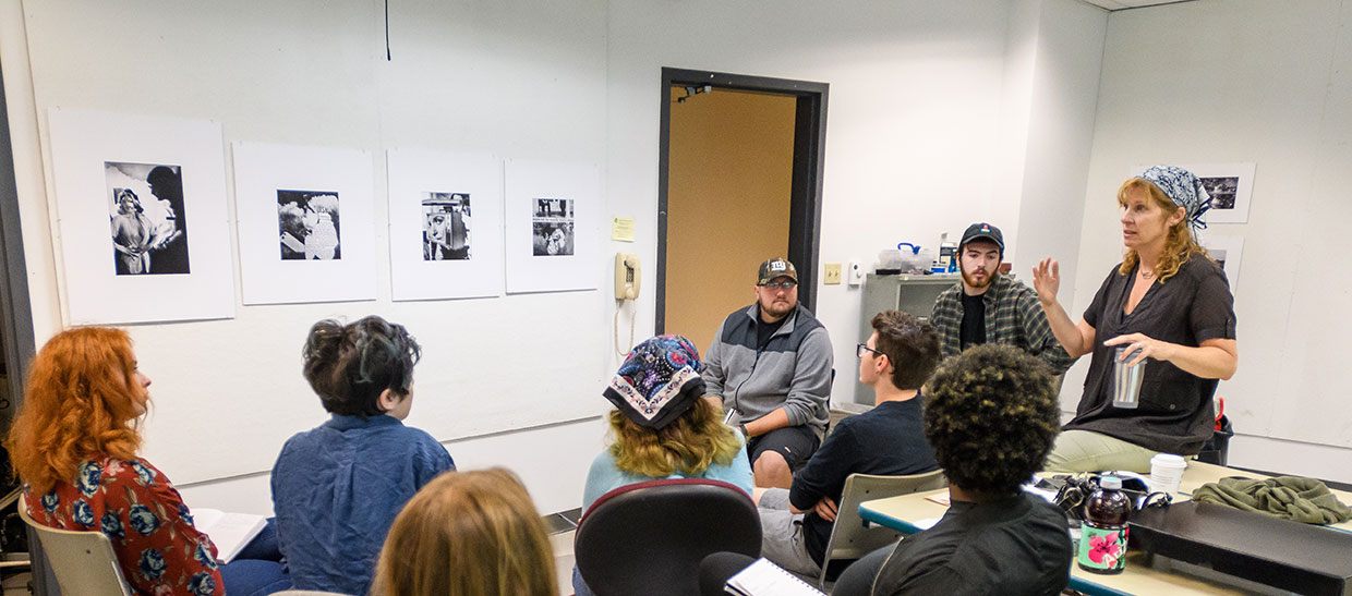 Gallery director Tara Fracalossi in classroom with students