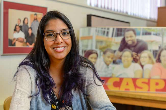Danielle Cartagenes in the Collegiate Academic Support Program office