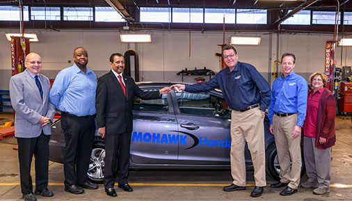 HVCC staff and members from Mohawk Honda in automotive lab