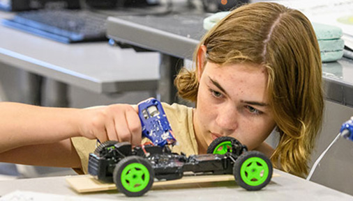 Students builds a car during camp